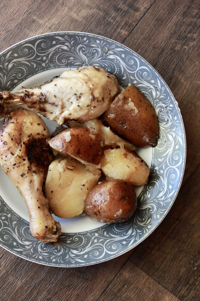 Chicken drumsticks and potaoes, close up picture