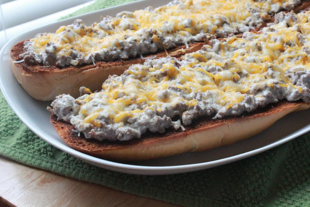 open-faced beef stroganoff sandwiches on platter