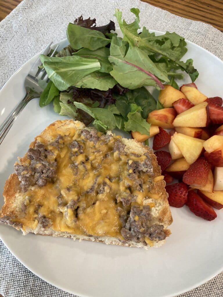 beef stroganoff sandwich served with salad