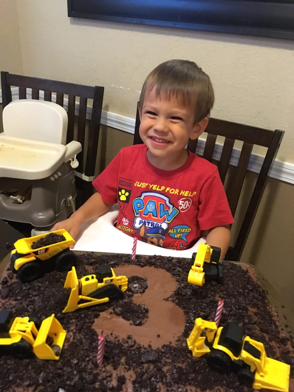 Child with 3 year birthday cake