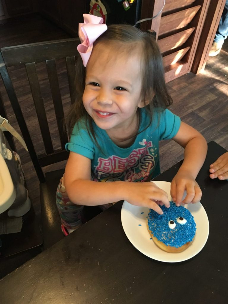 Girl with birthday donut